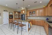 Kitchen/breakfast bar - Single Family Home for sale at 725 El Dorado Dr, Venice, FL 34285 - MLS Number is N5911780