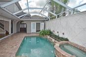 Pool to entry and bedroom - Single Family Home for sale at 248 Pensacola Rd, Venice, FL 34285 - MLS Number is N5914299