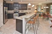 Breakfast bar, kitchen, dinette - Single Family Home for sale at 9124 Coachman Dr, Venice, FL 34293 - MLS Number is N5914408