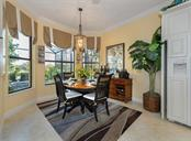 Dinette - Single Family Home for sale at 20122 Passagio Dr, Venice, FL 34293 - MLS Number is N5914419