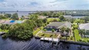 Overview of the Home and Myakka River. From here you see all the amenities, qualities and beautiful landscaping. This Quality Home with Many Upgrades Exhibits Pride of Ownership on Every Level. Truly a view of Waterfront Living at it's Best! Bring your boat, wave runner, fishing poles, swim suits and Enjoy the Florida Lifestyle. - Single Family Home for sale at 5149 Latham Ter, Port Charlotte, FL 33981 - MLS Number is N5914515