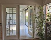 French doors to inside lanai - Villa for sale at 132 Inlets Blvd #132, Nokomis, FL 34275 - MLS Number is N5914693