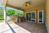 Outdoor kitchen - Single Family Home for sale at 5515 Reisterstown Rd, North Port, FL 34291 - MLS Number is N6100346