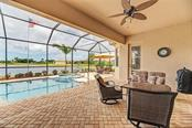 Lanai and pool - Single Family Home for sale at 20145 Cristoforo Pl, Venice, FL 34293 - MLS Number is N6100537