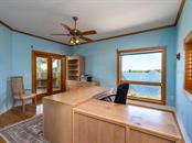 Office with doors to deck - Single Family Home for sale at 743 Eagle Point Dr, Venice, FL 34285 - MLS Number is N6101092