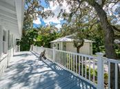 Deck to garage - Single Family Home for sale at 732 Eagle Point Dr, Venice, FL 34285 - MLS Number is N6102366
