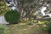 Yard - Single Family Home for sale at 1885 Neptune Dr, Englewood, FL 34223 - MLS Number is N6103051