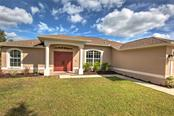 Attractive front entrance - Single Family Home for sale at 6612 Deer Run Rd, North Port, FL 34291 - MLS Number is N6103231