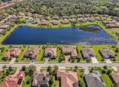 Aerial of lake - Single Family Home for sale at 19799 Cobblestone Cir, Venice, FL 34292 - MLS Number is N6104694