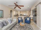 Family room to kitchen - Single Family Home for sale at 106 Vicenza Way, North Venice, FL 34275 - MLS Number is N6106168