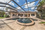 Lanai With Spa, Pool and Outdoor Kitchen. - Single Family Home for sale at 262 Pesaro Dr, North Venice, FL 34275 - MLS Number is N6107589