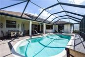 Pool view. - Single Family Home for sale at 2560 Pebble Creek Pl, Port Charlotte, FL 33948 - MLS Number is N6109100