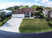 Aerial front of home. - Single Family Home for sale at 2560 Pebble Creek Pl, Port Charlotte, FL 33948 - MLS Number is N6109100