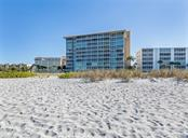 Looking toward the building from the beach - Condo for sale at 555 The Esplanade N #1004, Venice, FL 34285 - MLS Number is N6109326
