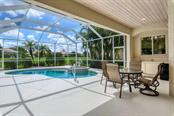 Extremely large outdoor entertaining area - Single Family Home for sale at 601 Cockatoo Cir, Venice, FL 34285 - MLS Number is N6111658