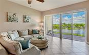 Great room with sliders - Condo for sale at 167 Tampa Ave E #313, Venice, FL 34285 - MLS Number is N6112536