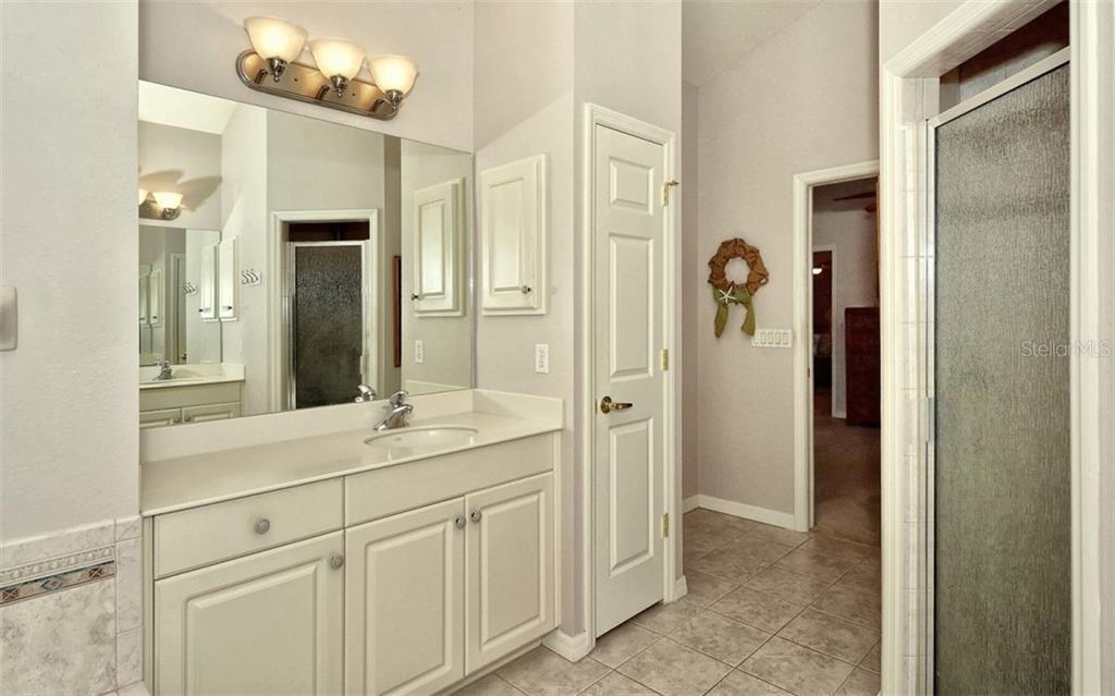 Master Bath with access to Pool area - Single Family Home for sale at 1141 Arbroid Dr, Englewood, FL 34223 - MLS Number is D6101353