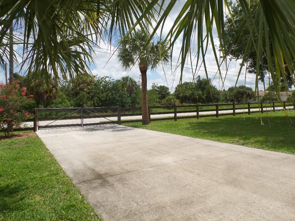 115 FT LONG X 16.5 FT WIDE DRIVE TO COVERED CAR/BOAT AWNING WITH CONCRETE SLAB. - Single Family Home for sale at 28435 Sabal Palm Dr, Punta Gorda, FL 33982 - MLS Number is C7240870