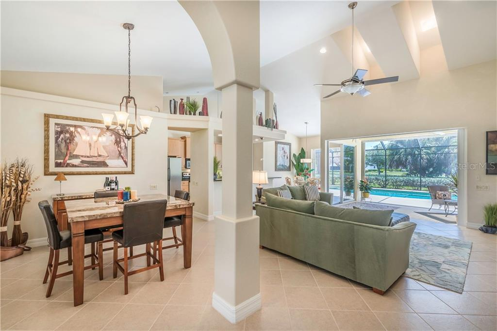 Semi-formal dining room is open to the great room. - Single Family Home for sale at 931 Linkside Way, Punta Gorda, FL 33955 - MLS Number is C7400849