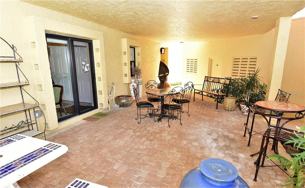Use this bricked, covered Patio in rain or shine!  This Patio is very unique to Marina Southshore.  It was installed for the benefit of the unit owner as well as the members of Southshore. - Condo for sale at 3210 Southshore Dr #11a, Punta Gorda, FL 33955 - MLS Number is C7402449