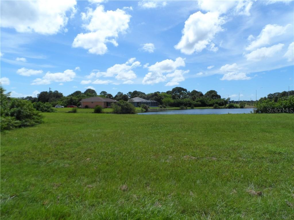 From the front of the lot looking toward the water. - Vacant Land for sale at 119 Rifle Rd, Rotonda West, FL 33947 - MLS Number is C7406393