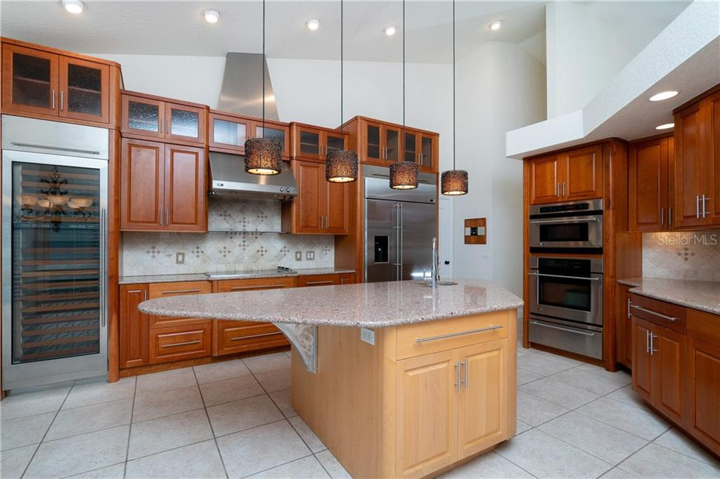 Great center Island made of Maple Wood Cabinets with a vegetable sink and lots or counter space. - Single Family Home for sale at 1309 Casey Key Dr, Punta Gorda, FL 33950 - MLS Number is C7413790