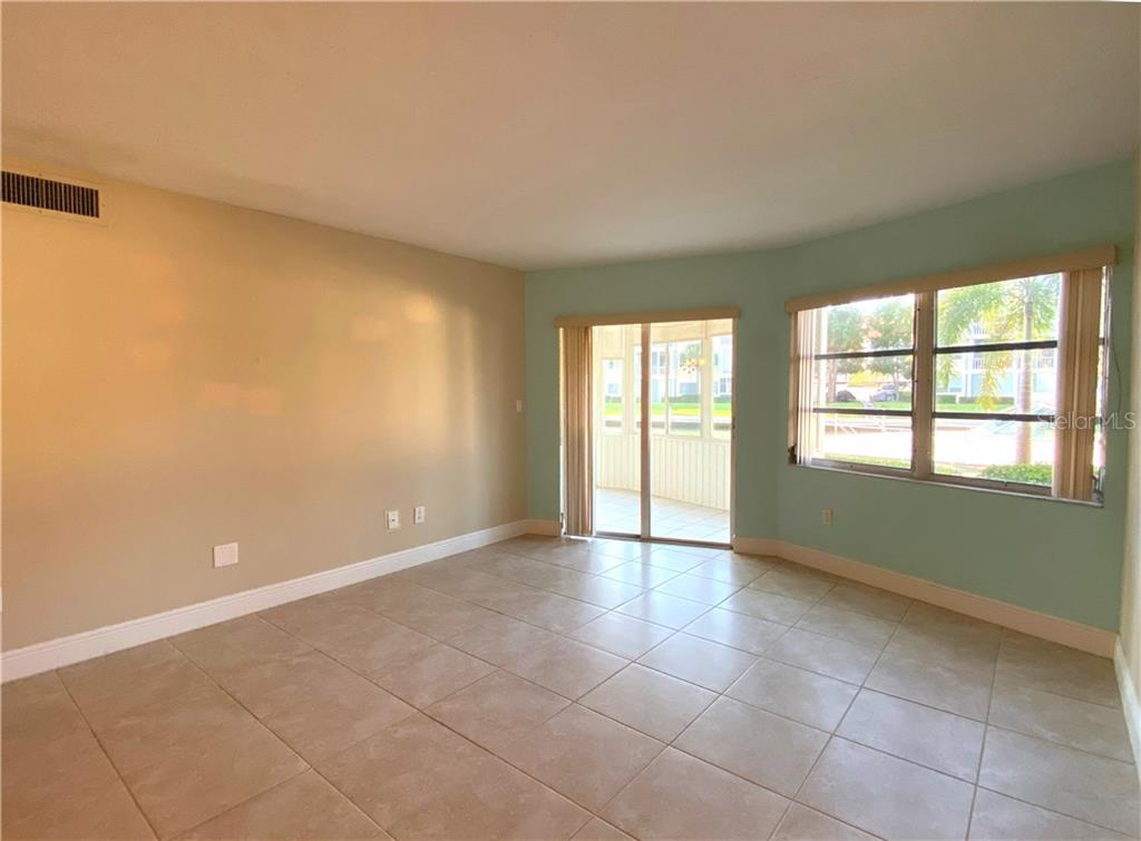 LIVING ROOM TO LANAI - Condo for sale at 1257 S Portofino Dr #106 (#38), Sarasota, FL 34242 - MLS Number is C7421453