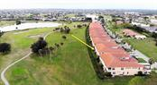 Aerial view of home's location.  Association owns large buffer behind units with protected view. - Condo for sale at 3959 San Rocco Dr #212, Punta Gorda, FL 33950 - MLS Number is C7409637
