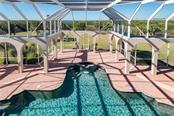 VIEW OVERLOOKING THE POOL - Single Family Home for sale at 13000 Windcrest Dr, Port Charlotte, FL 33953 - MLS Number is C7410459