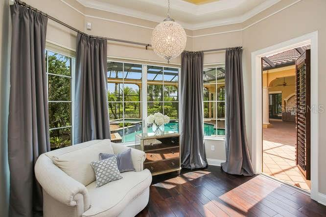 A closer view of the master suite, sitting area.  Hop out the bedroom door to the pool and enjoy the morning sun in totally privacy. - Single Family Home for sale at 8365 Catamaran Cir, Lakewood Ranch, FL 34202 - MLS Number is A4187448