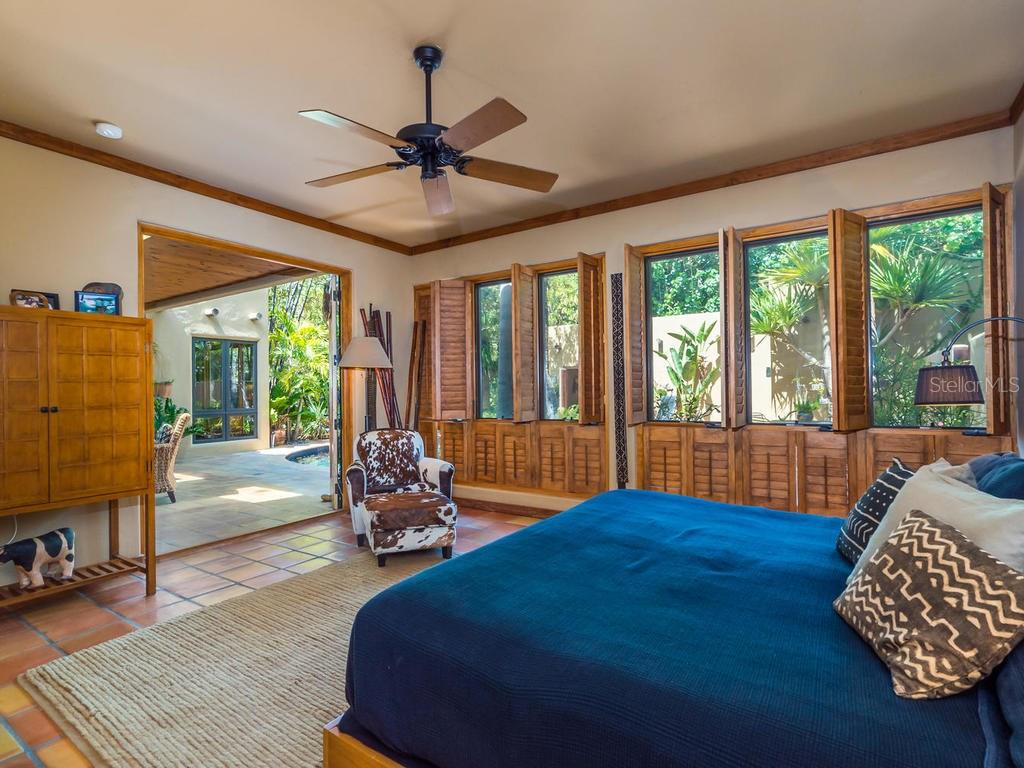 Master bedroom with floor to ceiling windows - Single Family Home for sale at 7340 Pine Needle Rd, Sarasota, FL 34242 - MLS Number is A4200855