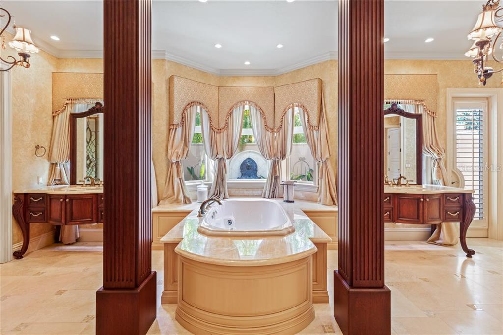 Spectacular master suite bath with his and her spaces, garden soaking tub, and lots of built-in cabinetry. - Single Family Home for sale at 7320 Barclay Ct, University Park, FL 34201 - MLS Number is A4200908