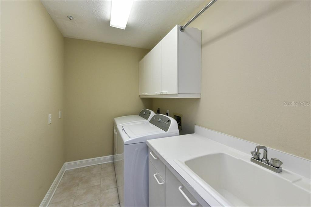 Laundry room with wet sink. - Single Family Home for sale at 3947 Somerset Dr, Sarasota, FL 34242 - MLS Number is A4201541