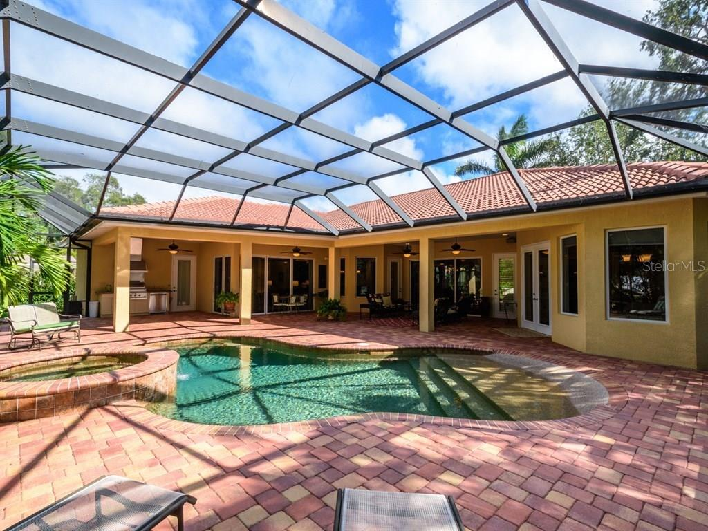 Single Family Home for sale at 7654 Cove Ter, Sarasota, FL 34231 - MLS Number is A4201743