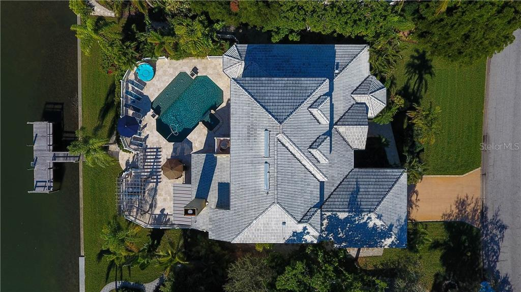 This isn't a GOOGLE EARTH Shot...   Our Drone photographer is a master... showcasing how well the home is set up on this homesite...  Quiet street, low fees, minutes to everything important, and NO ISLAND TRAFFIC JAMS in SEASON just trying to get off the Key!  Low insurance costs here too.  One of Sarasota's Best WATERFRONT values for an amazing home with great views and so much to offer. - Single Family Home for sale at 5824 Tidewood Ave, Sarasota, FL 34231 - MLS Number is A4205461
