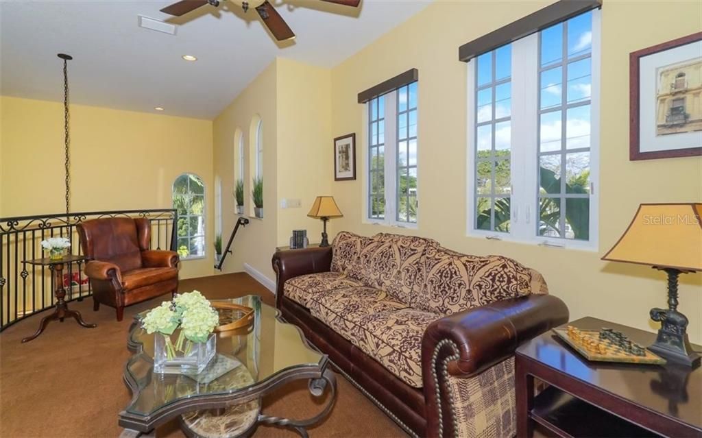 Upstairs den adjoins to the master suite - Single Family Home for sale at 1179 Morningside Pl, Sarasota, FL 34236 - MLS Number is A4209174