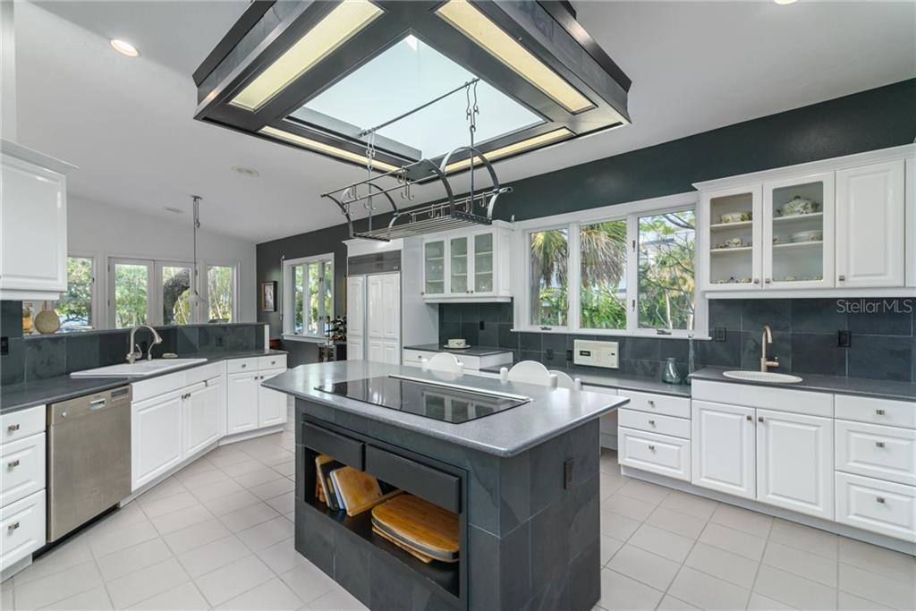 Gourmet Kitchen with Island - Single Family Home for sale at 6609 Peacock Rd, Sarasota, FL 34242 - MLS Number is A4210220