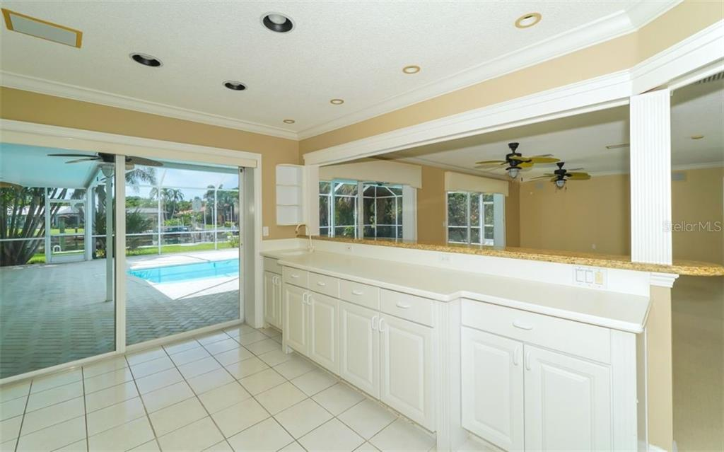 Even while making dinner you get to look out at a relaxing view. Or chat with friends as they sit at the counter. - Single Family Home for sale at 390 Bob White Dr, Sarasota, FL 34236 - MLS Number is A4413388