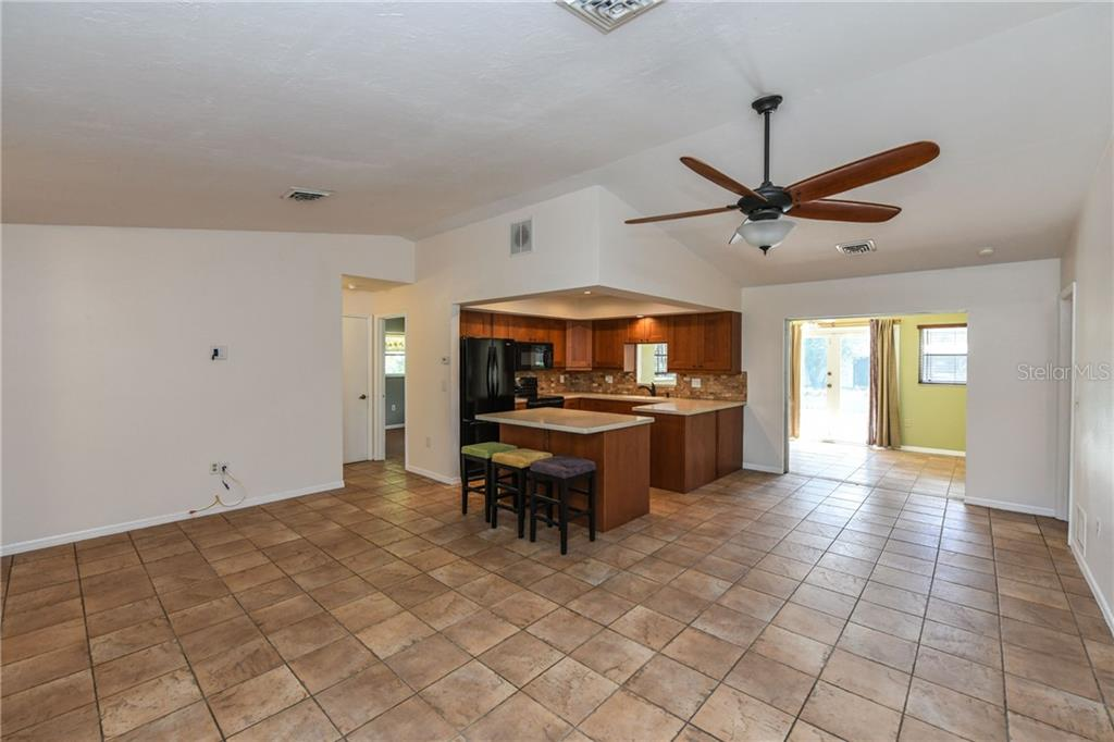 Open concept family room into the kitchen. - Single Family Home for sale at 2045 Frederick Dr, Venice, FL 34292 - MLS Number is A4416740