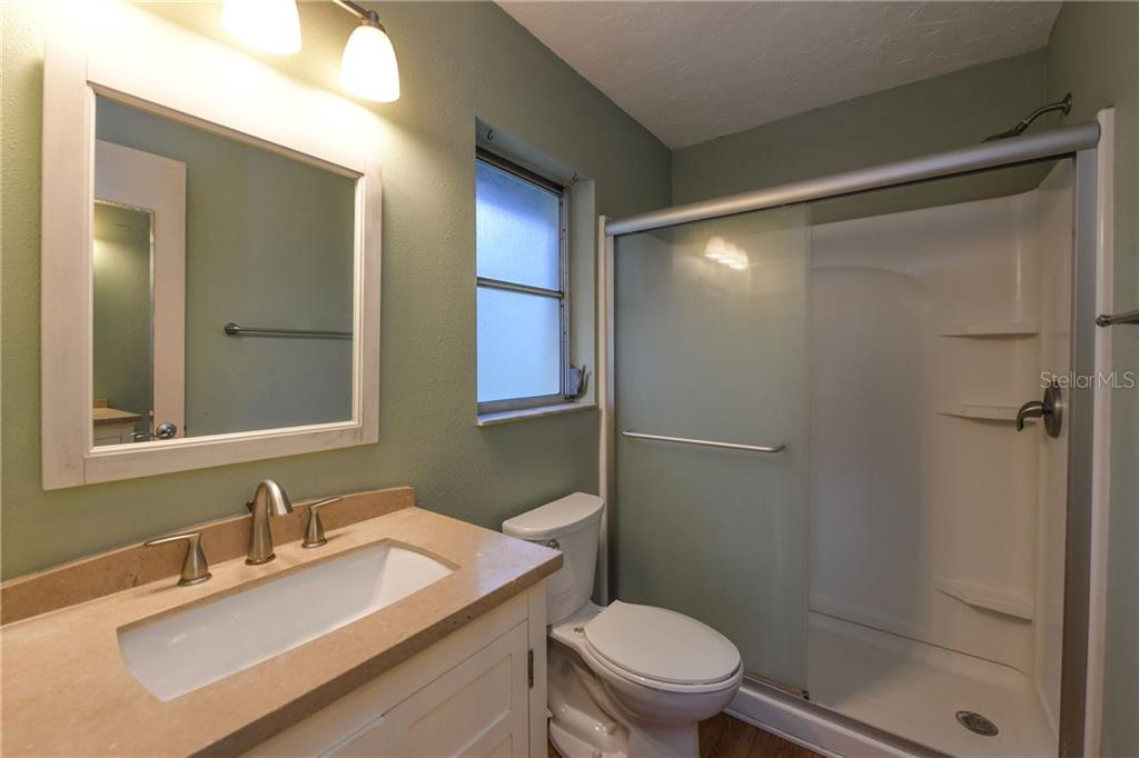 Renovated master bath. - Single Family Home for sale at 2045 Frederick Dr, Venice, FL 34292 - MLS Number is A4416740