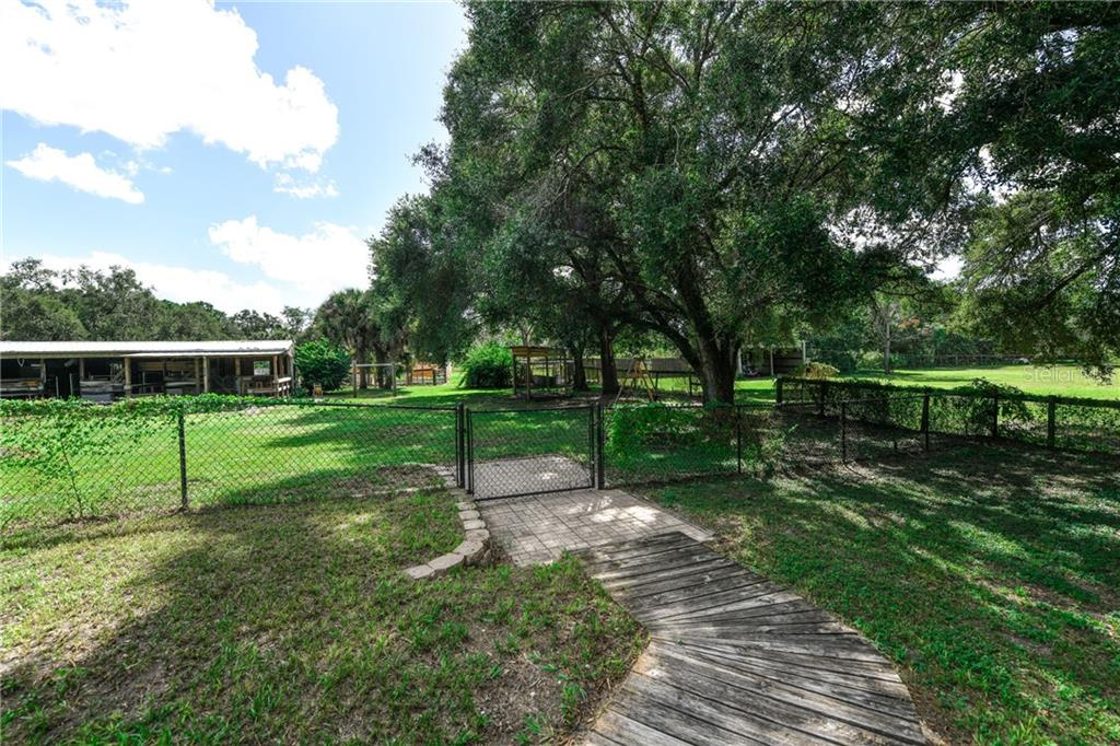 Horse stalls in their own fenced area. - Single Family Home for sale at 2045 Frederick Dr, Venice, FL 34292 - MLS Number is A4416740