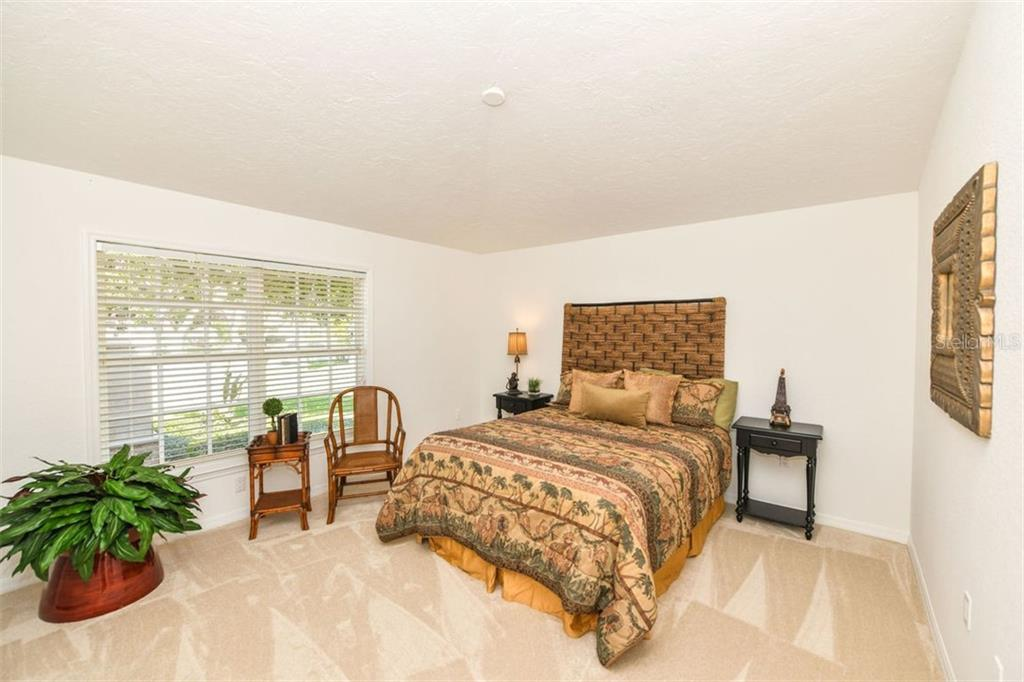 One of two lower level en-suite bedroom. - Single Family Home for sale at 7689 Cove Ter, Sarasota, FL 34231 - MLS Number is A4417242