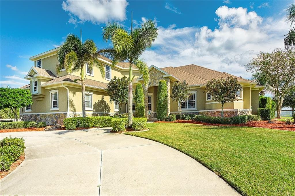 Single Family Home for sale at 5510 Lake Paddock Cir, Parrish, FL 34219 - MLS Number is A4418895