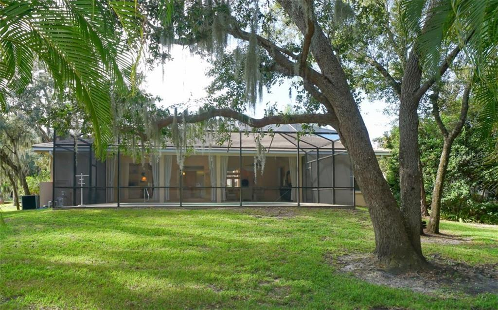 Backyard, lush & landscaped. - Single Family Home for sale at 6125 Varedo Ct, Sarasota, FL 34243 - MLS Number is A4420656