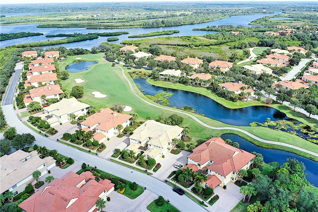 Overhead view of 8th hole with the Manatee River in the background. - Condo for sale at 9453 Discovery Ter #201c, Bradenton, FL 34212 - MLS Number is A4423314