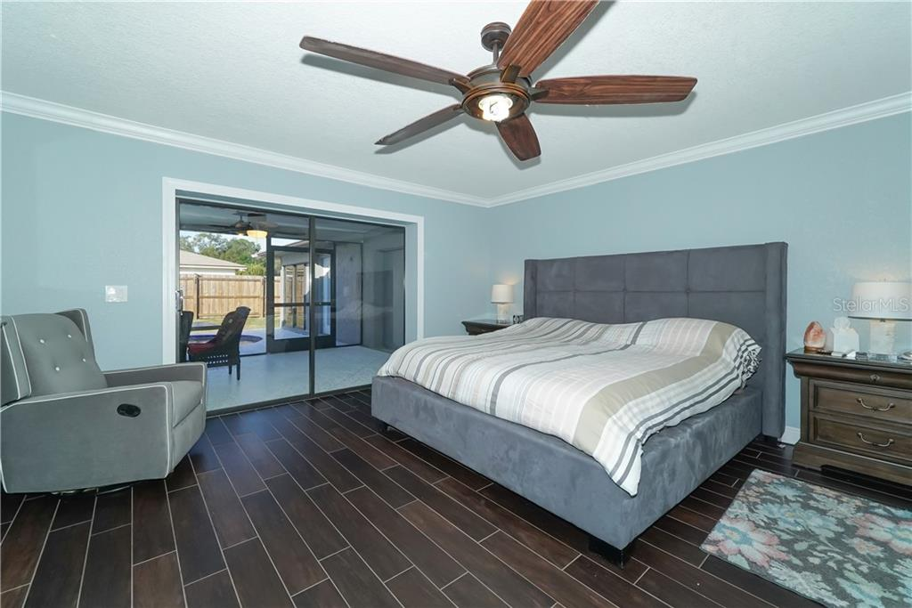Master bedroom with view of the pool. - Single Family Home for sale at 8106 Timber Lake Ln, Sarasota, FL 34243 - MLS Number is A4423770