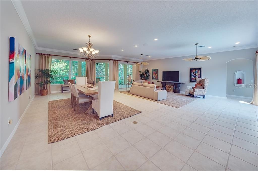 Wonderfully spacious great room/dining room combination.  Loads of wall space for an art collection. - Single Family Home for sale at 2972 Jeff Myers Cir, Sarasota, FL 34240 - MLS Number is A4424133