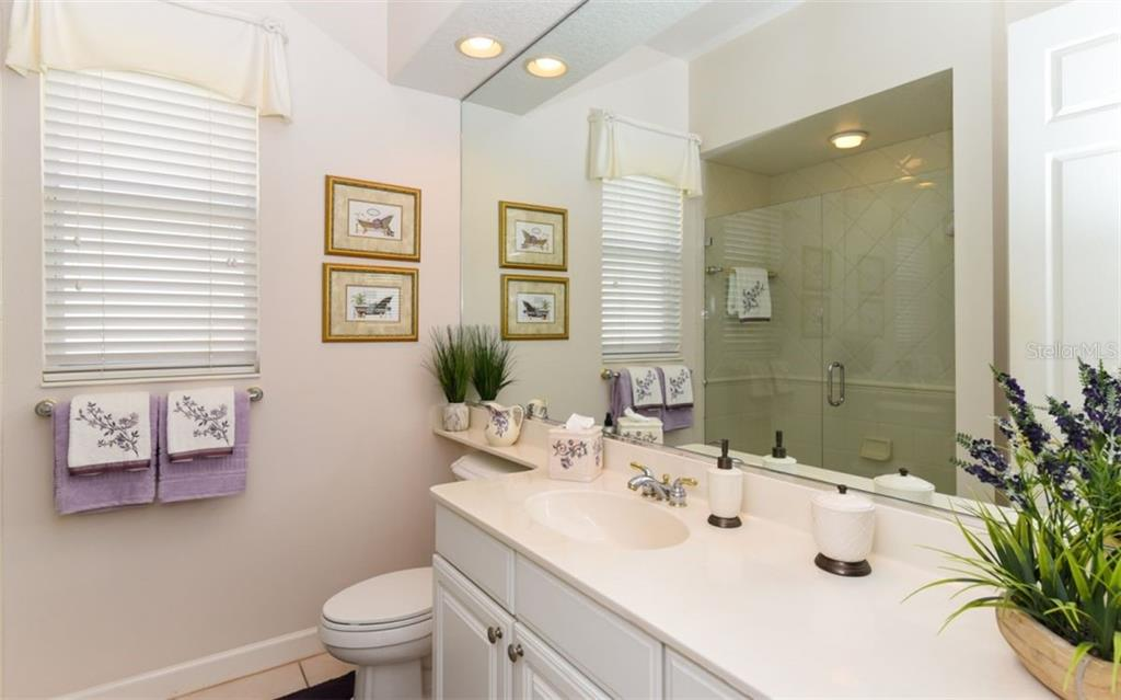 Large guest bath with frameless glass shower door! - Single Family Home for sale at 8473 Eagle Preserve Way, Sarasota, FL 34241 - MLS Number is A4425945
