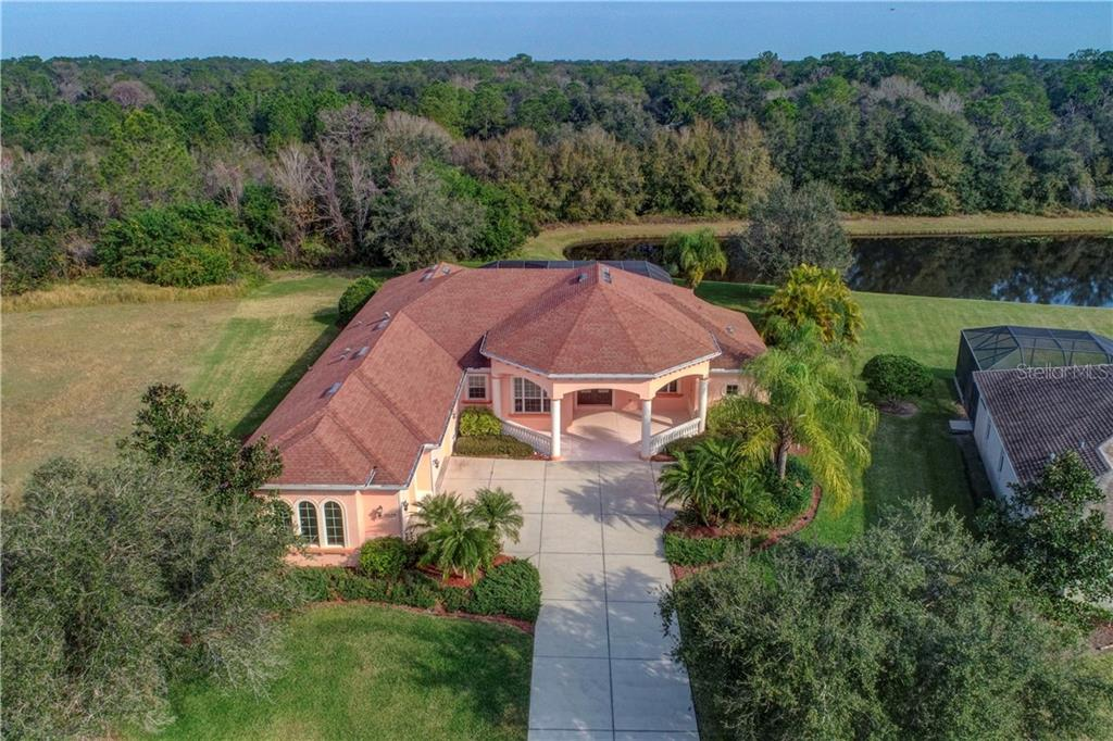 Over 1/2 of an acre of beautiful landscaping, mature trees, and lake view. - Single Family Home for sale at 15109 17th Ave E, Bradenton, FL 34212 - MLS Number is A4425963