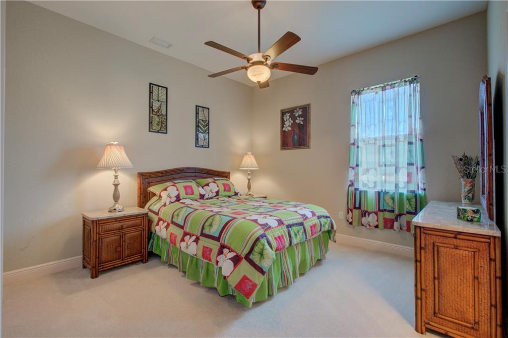 The 2nd bedroom is located just off the kitchen.  It has its own entrance to the shared/Jack-and-Jill bathroom. - Single Family Home for sale at 15109 17th Ave E, Bradenton, FL 34212 - MLS Number is A4425963